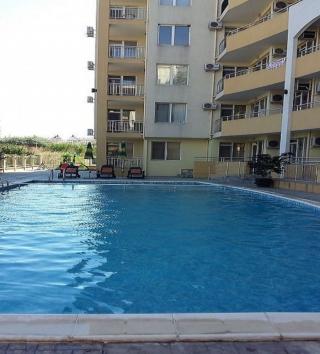 Недвижимость в Болгарии двухкомнатная квартира в Поморие с низкой таксой за обслуживания