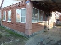 Продам кирпичный дом в центре станицы Холмской